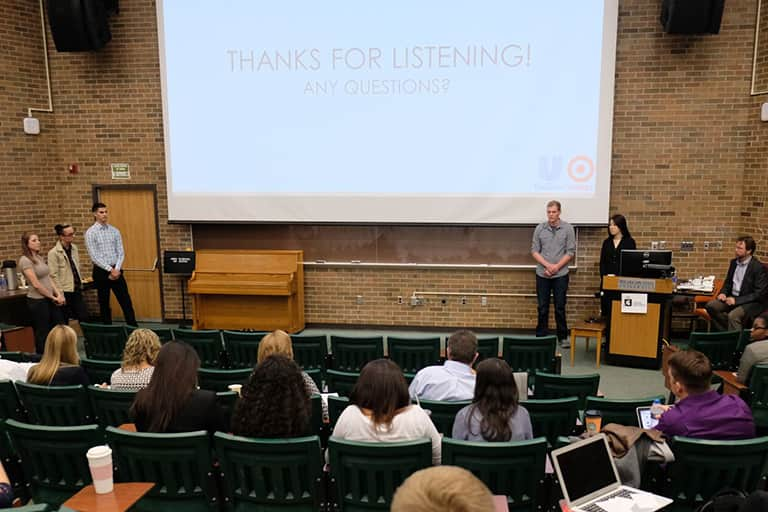 Advertising students in ADV 492 class giving a presentation to clients in ComArtSci lecture hall room 145.