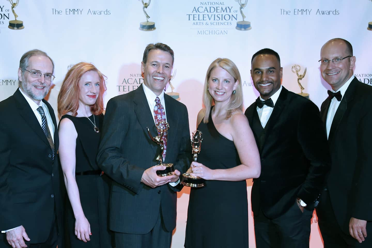 "WKAR wins an EMMY for ""Curious Crew"" with Rob Stephenson at the 2016 Michigan Emmy Awards, MotorCity Casino. (l-r) Gary Reid, Nicole Zaremba, Rob Stephenson, Susi Elkins, Al Martin, Jason Vlahos. 6/18/2016. photo: Tim Elkins/WKAR-MSU"