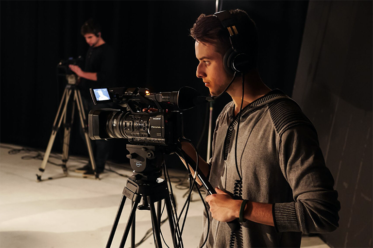 Man broadcasting with camera