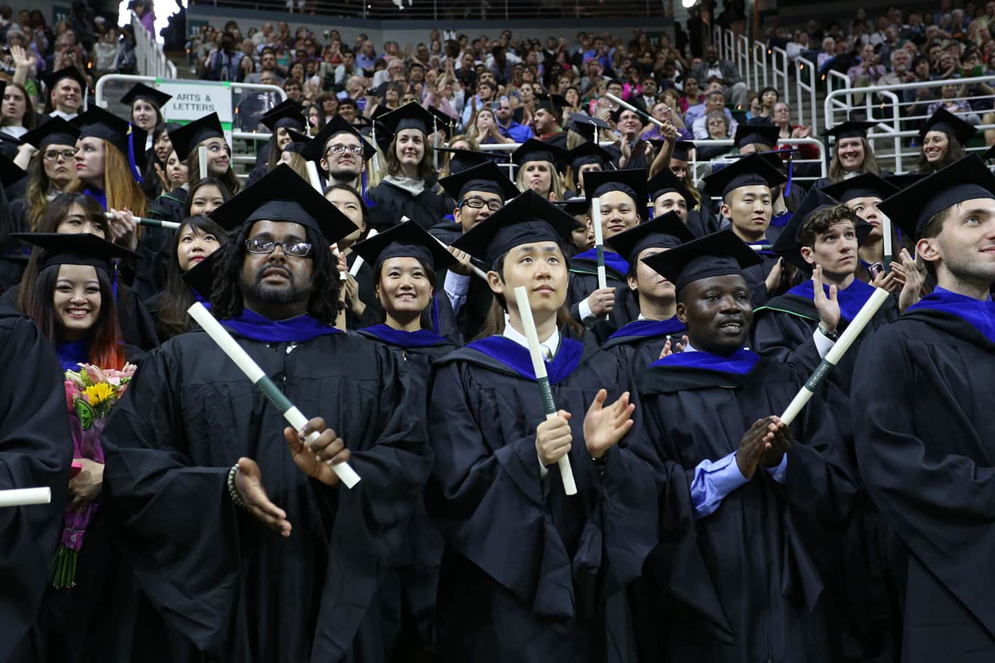 Graduate students at their graduation ceremony