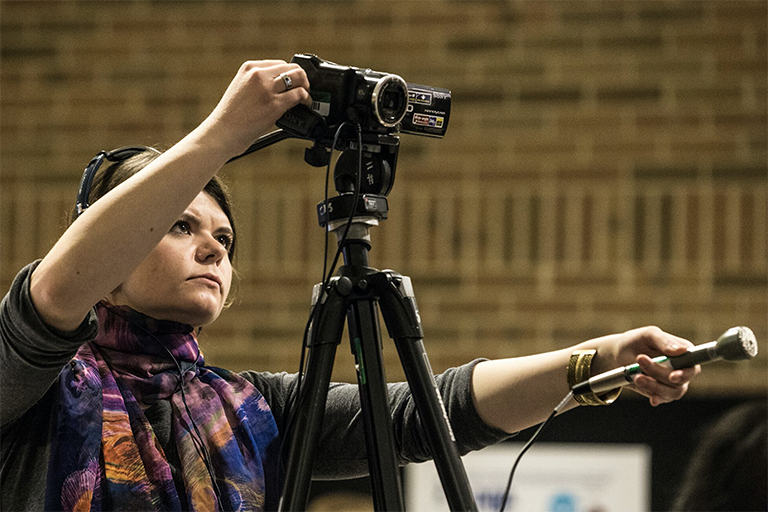 Woman filming with microphone