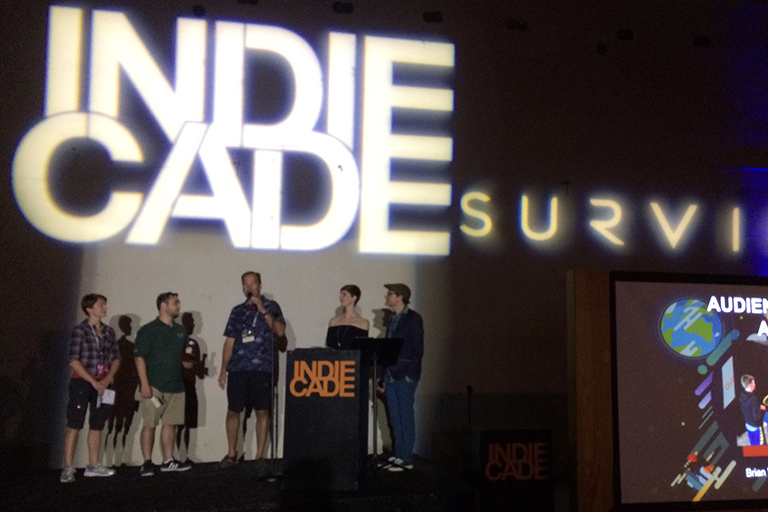 The Plunder Panic team accepting their award on stage.