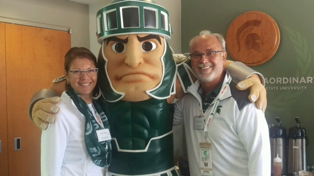 Merri Jo Bales and Randy Sahajdack with Sparty the mascot