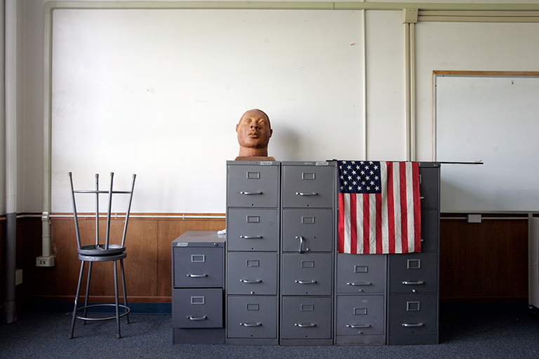 Statue of a head on filing cabinets