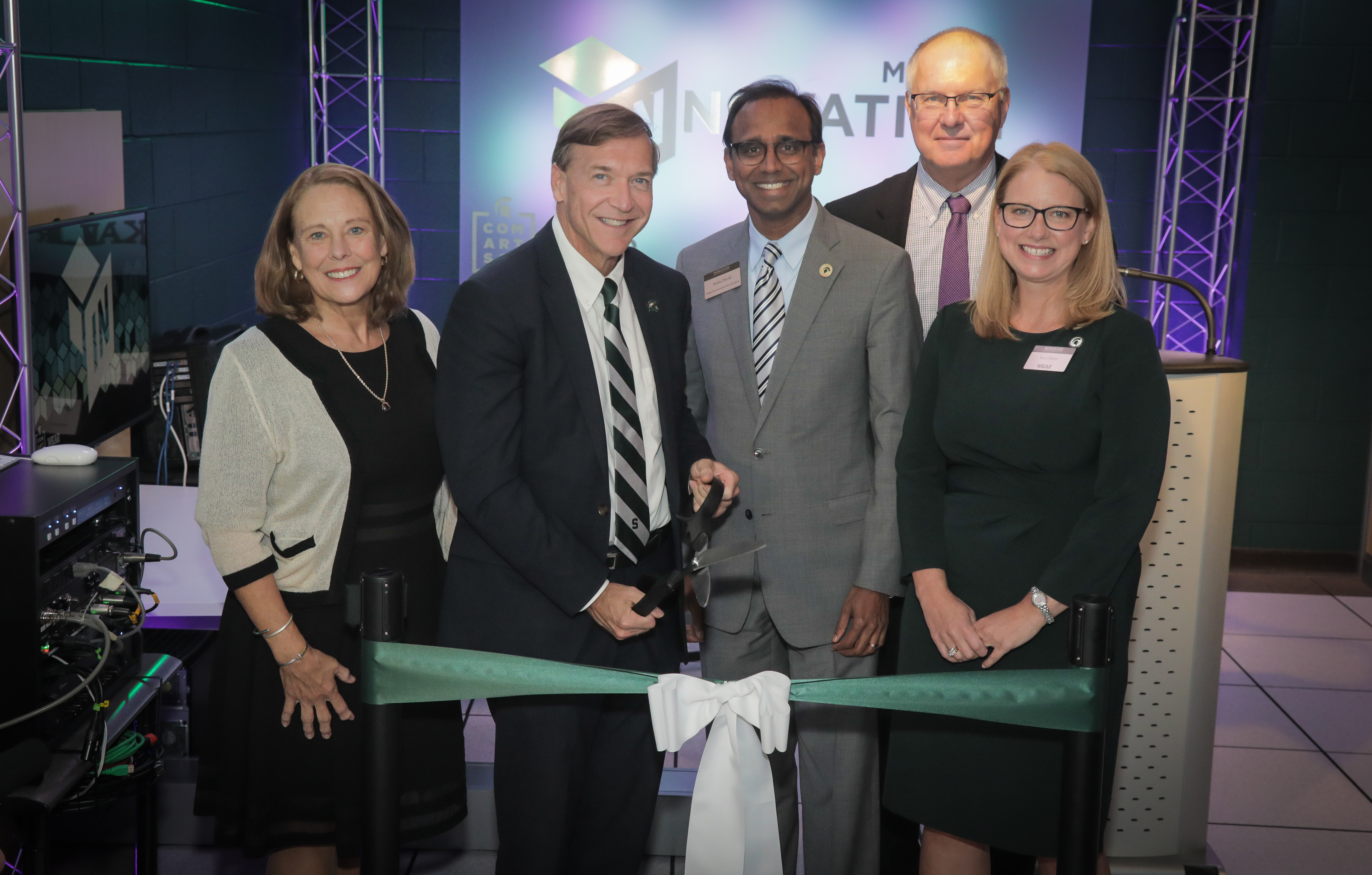 Photo of APTS Executive Vice President Lonna Thompson, MSU President Samuel Stanley Jr., Dean Prabu David, UNC-TV's Fred Engel, and WKAR General Manager Susi Elkins cutting the ribbon to open the NextGen Media Innovation Lab.