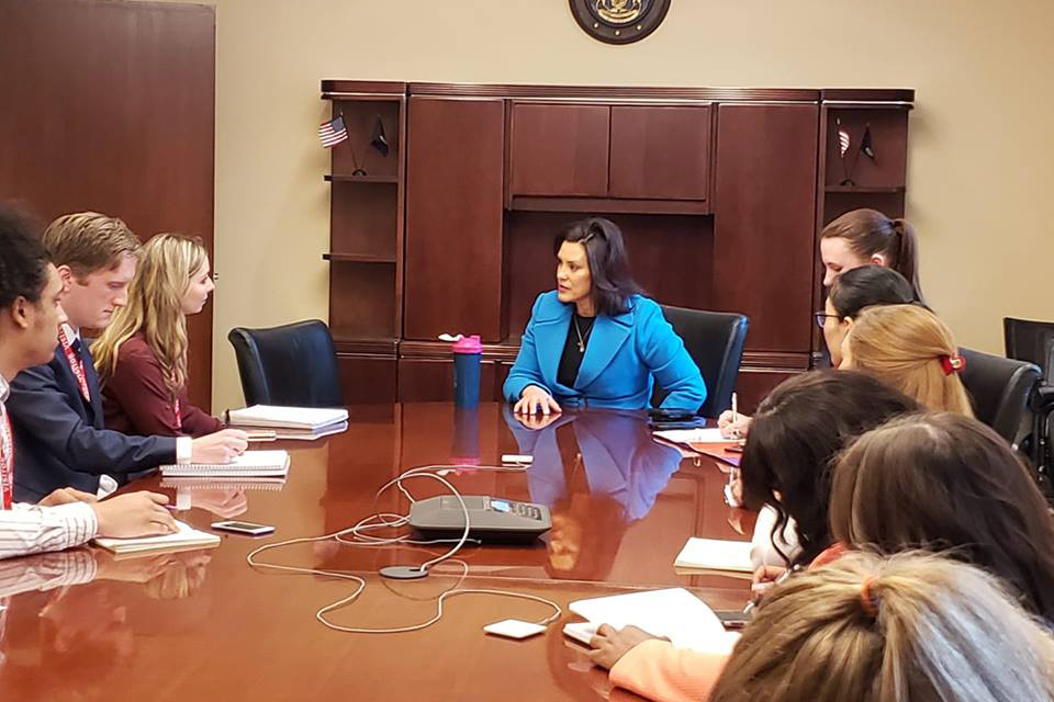 Gov. Whitmer siting with CNS correspondents