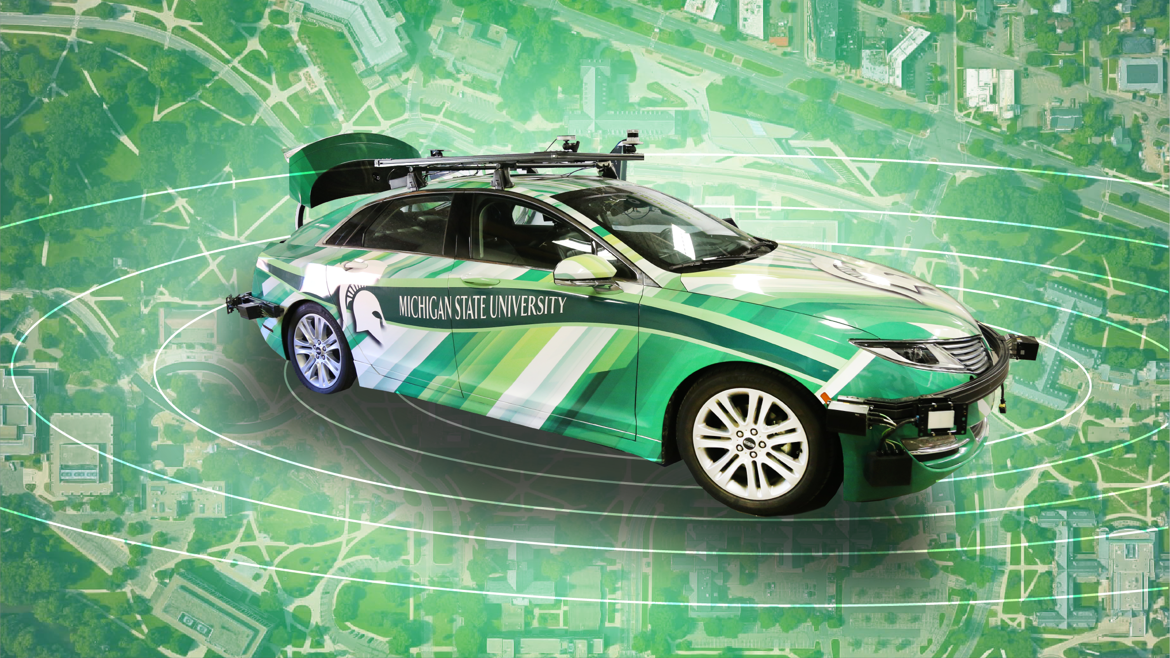 Graphic with photo of MSU's self-driving car