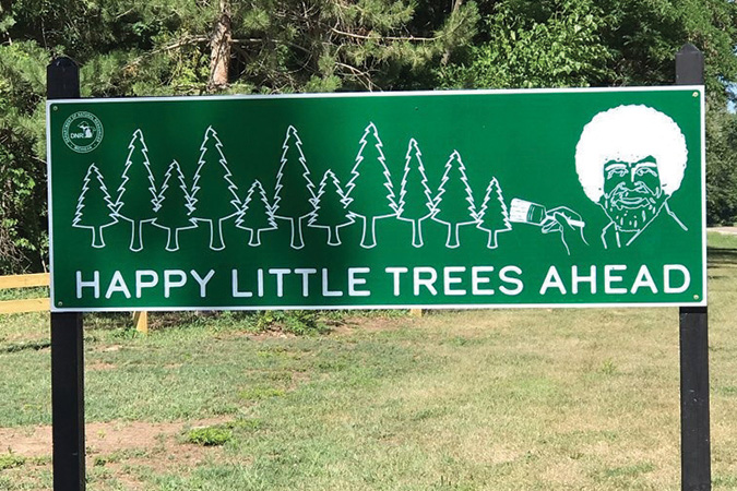One of the Happy Little Trees signs located outside of Michigan State Parks