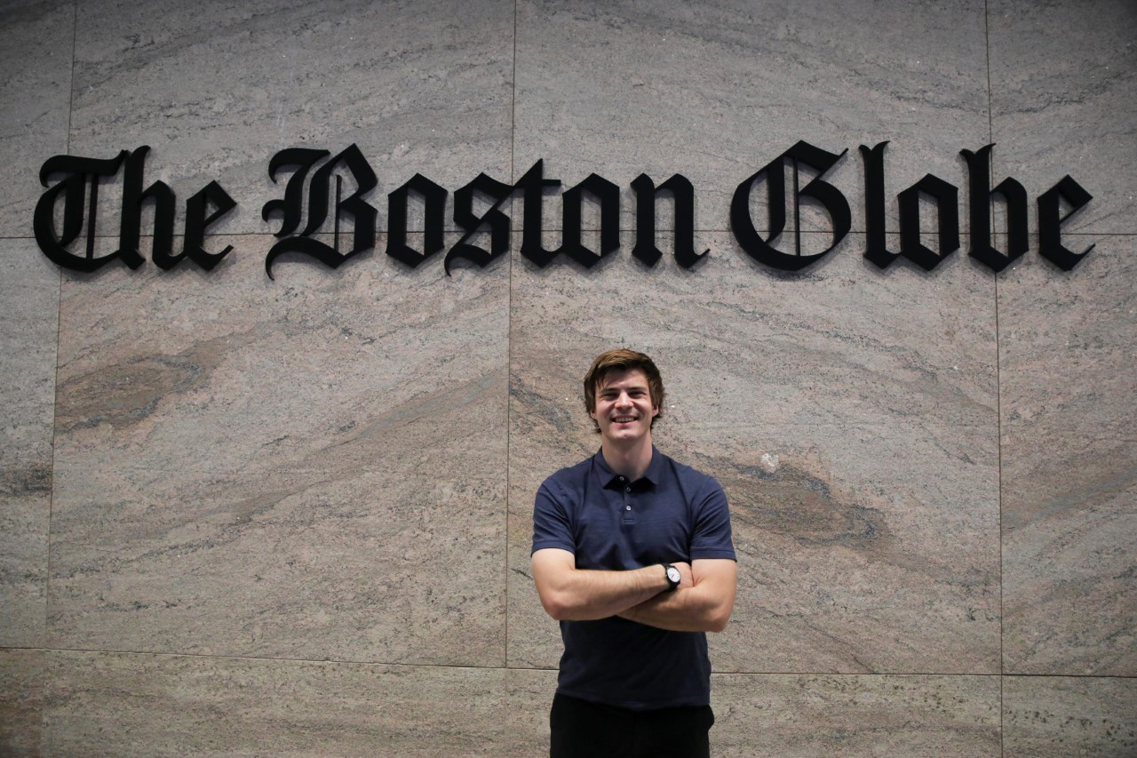 Antaya standing in front of The Boston Globe