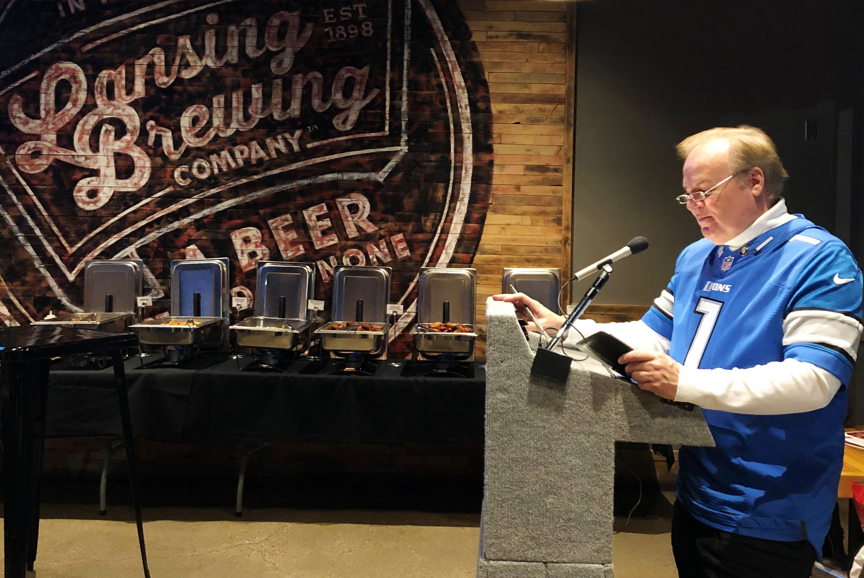 Bob Kolt speaks to professors at Lansing Brewing Company.