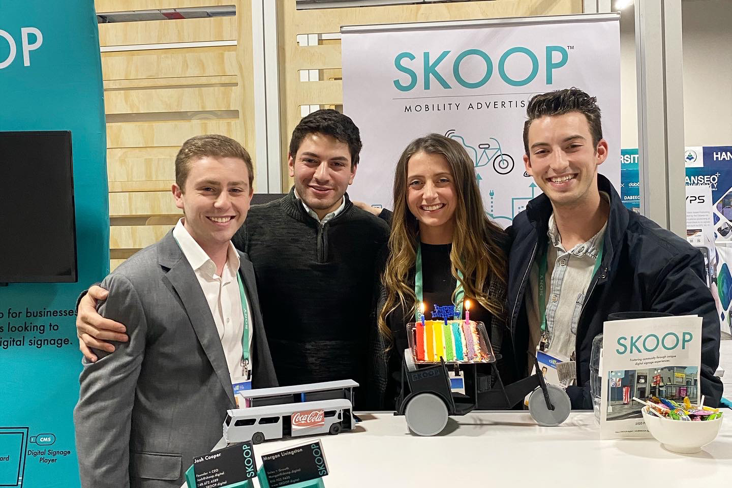 SKOOP crew inside CES booth