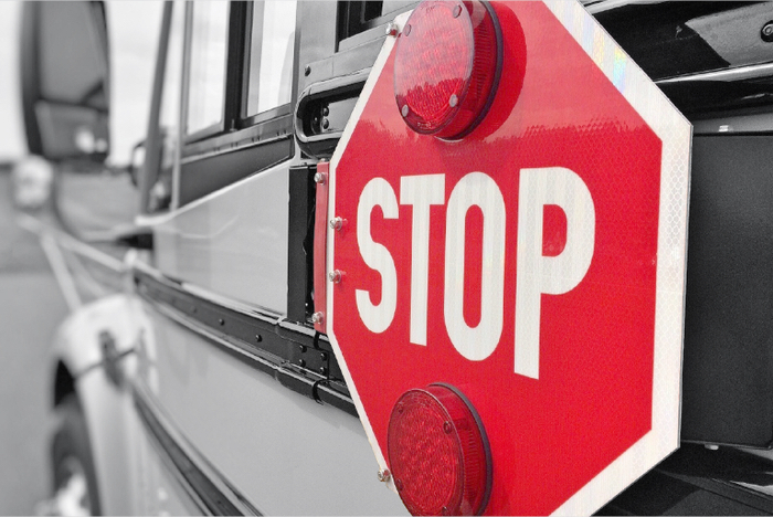 Photo of a stop sign on a school bus