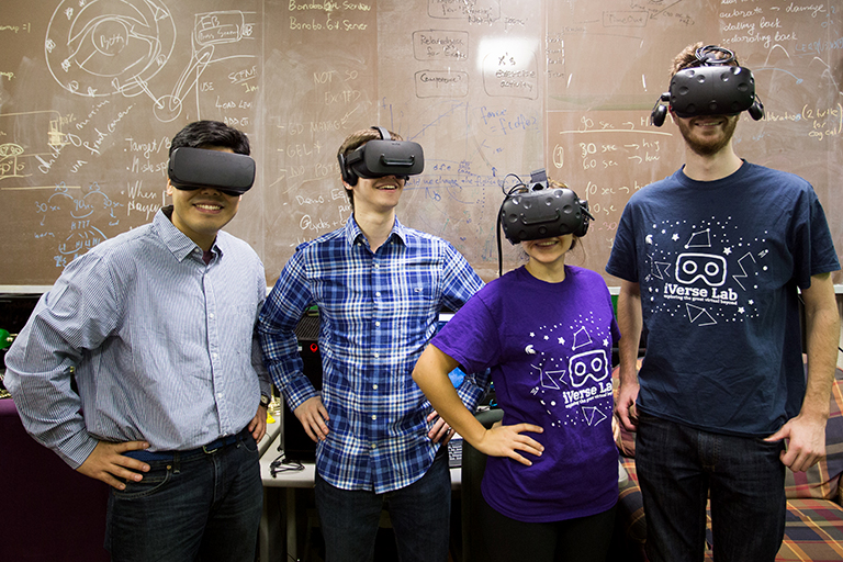 Photo of people wearing virtual reality goggles