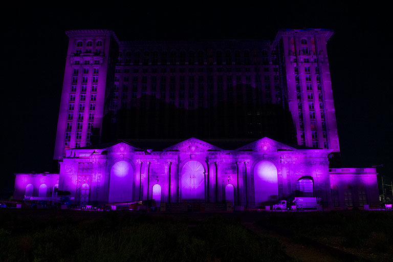 Photo of the Michigan Central Station Lit in Purple