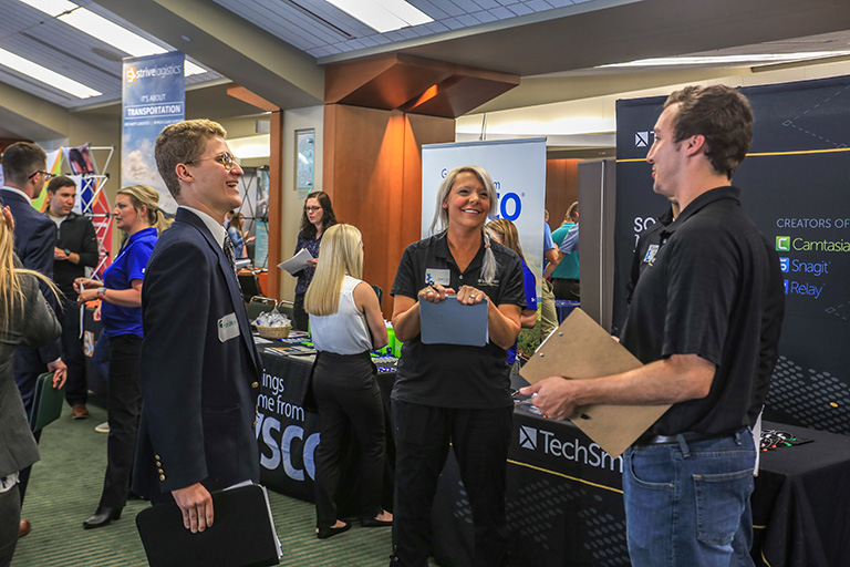 Students talking at a career expo