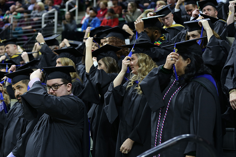 StratCom students in stands at graduation