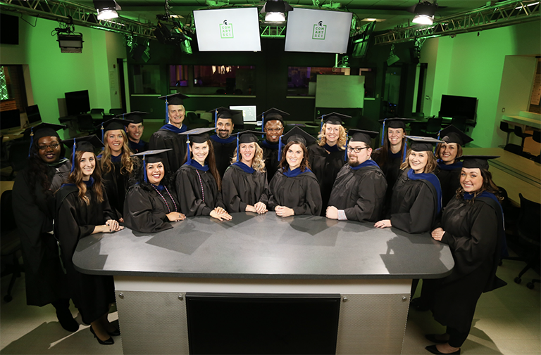 Group of graduates in green-light room