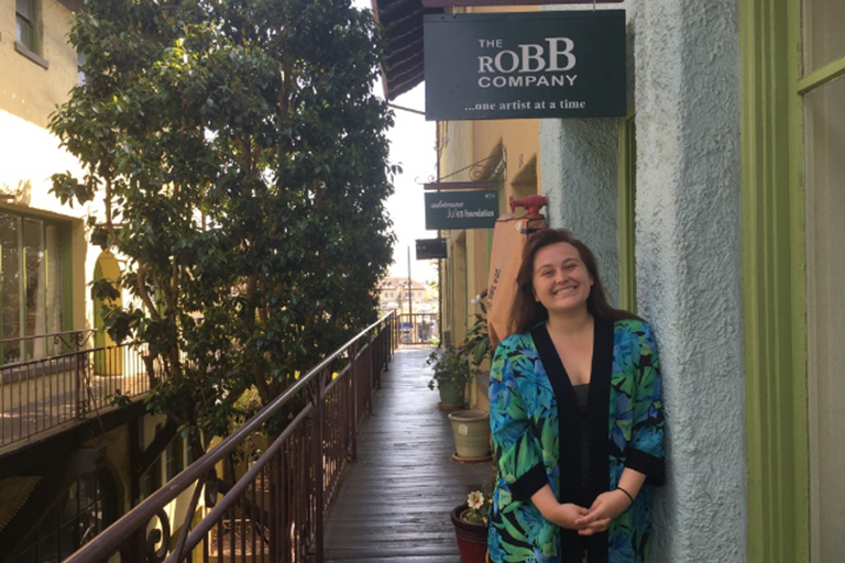 ComArtSci senior Sidney Anderson in front of the Robb Company in L.A.