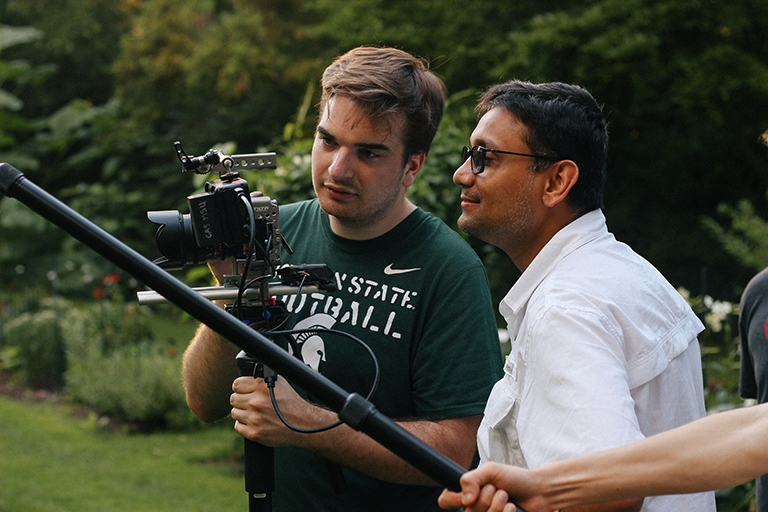 Professor Amol Pavangadkar helping a student with camera angles.