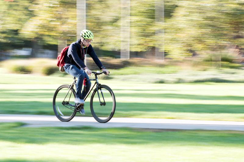 Student biking on campus