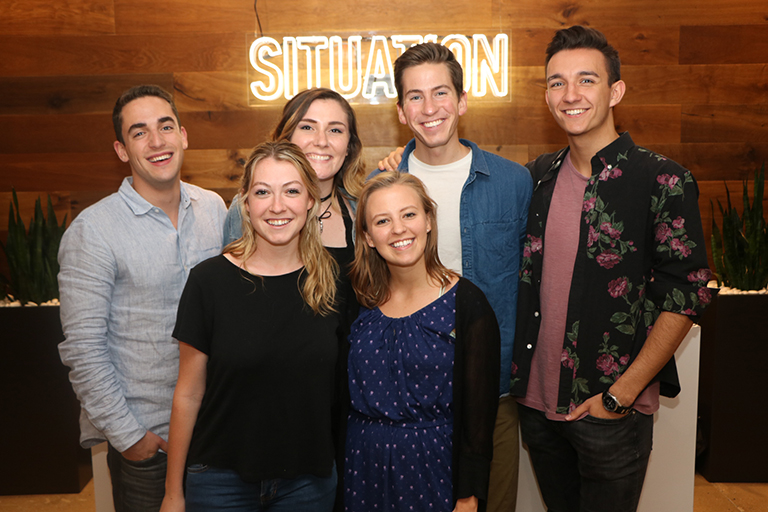 Advertising senior Kendall Buzzy (front row in blue dress) with fellow interns at Situation Interactive in NYC.