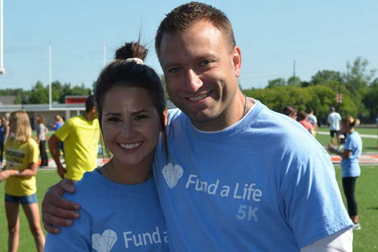 Junior Breanna Cockerill poses with her former coach, Mark Howell, after the Fund a Life 5k.