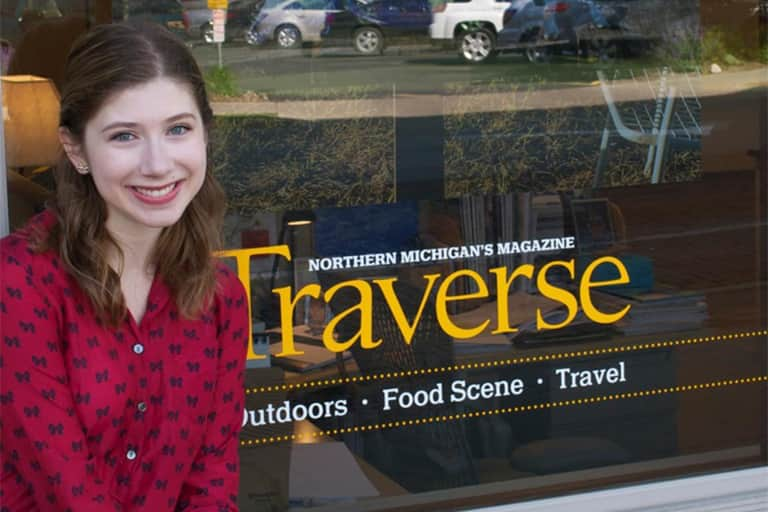 Kathryn McLravy in front of Traverse Magazine