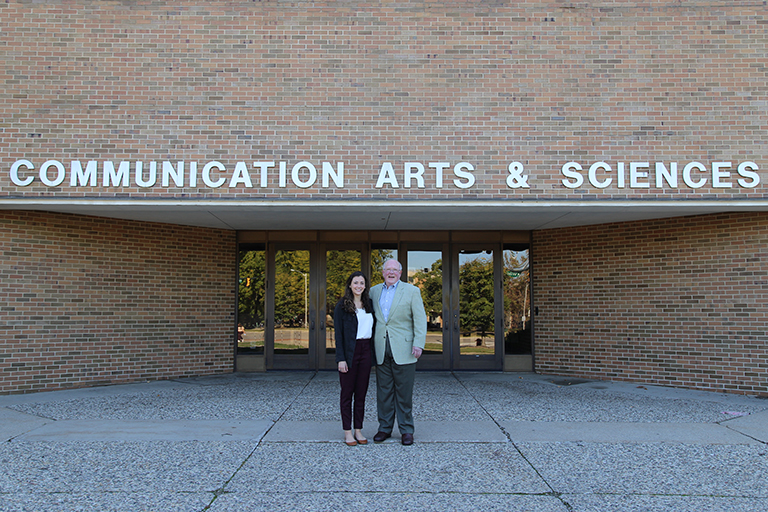Alumnus Tony Hopp and senior Cara Murphy in front of the ComArtSci building.