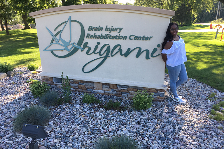 Keyara Newkirk outside her internship at Origami Brain Injury Rehabilitation Center