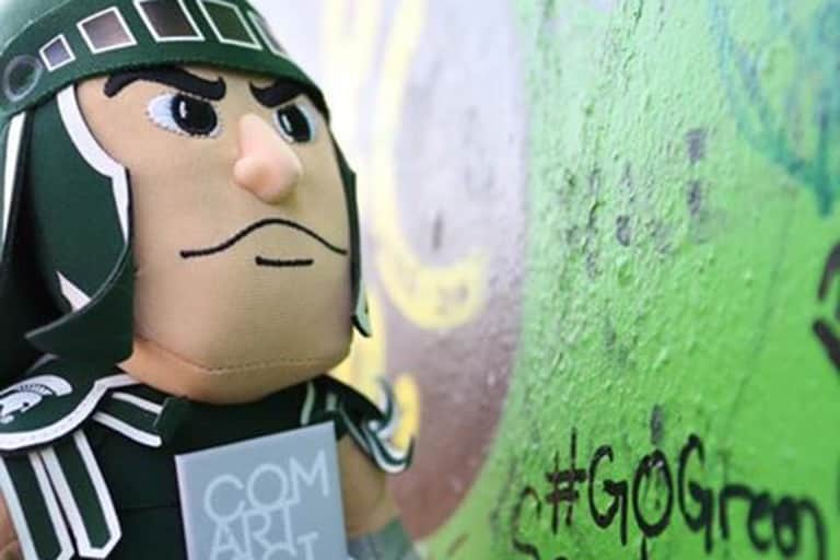 Sparty writes on the peace wall in Belfast