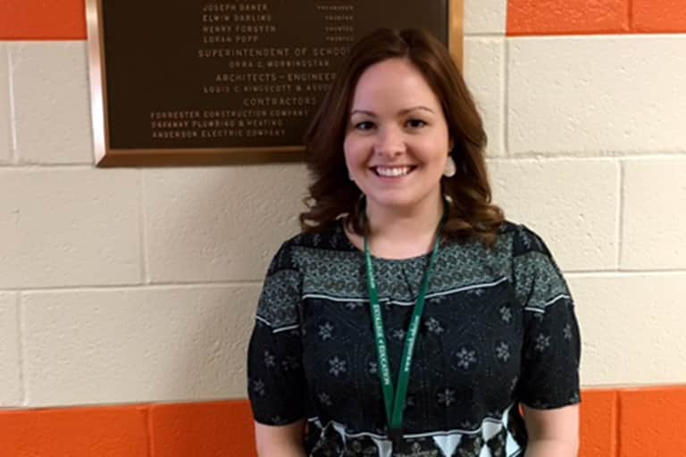 CSD intern Ashley Buza standing for photo in the hallway of Saginaw Intermediate School District building.