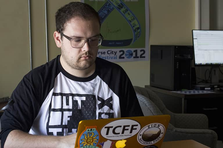 Traverse City Film Festival intern Eric Schwartz working on his computer.