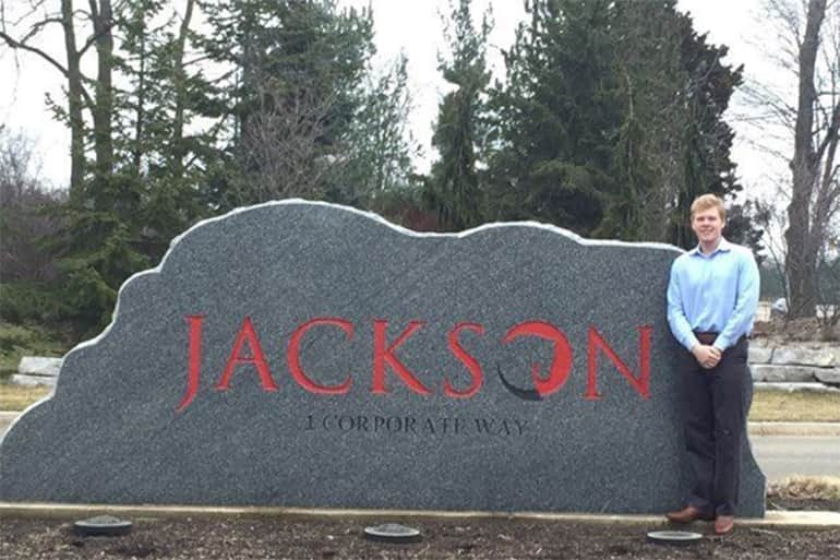 Mitch Marier standing outside next to the Jackson National Life Stone.