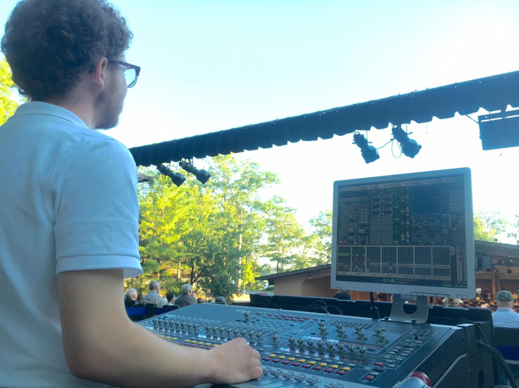 Arthur Jones working the sound board at an event.
