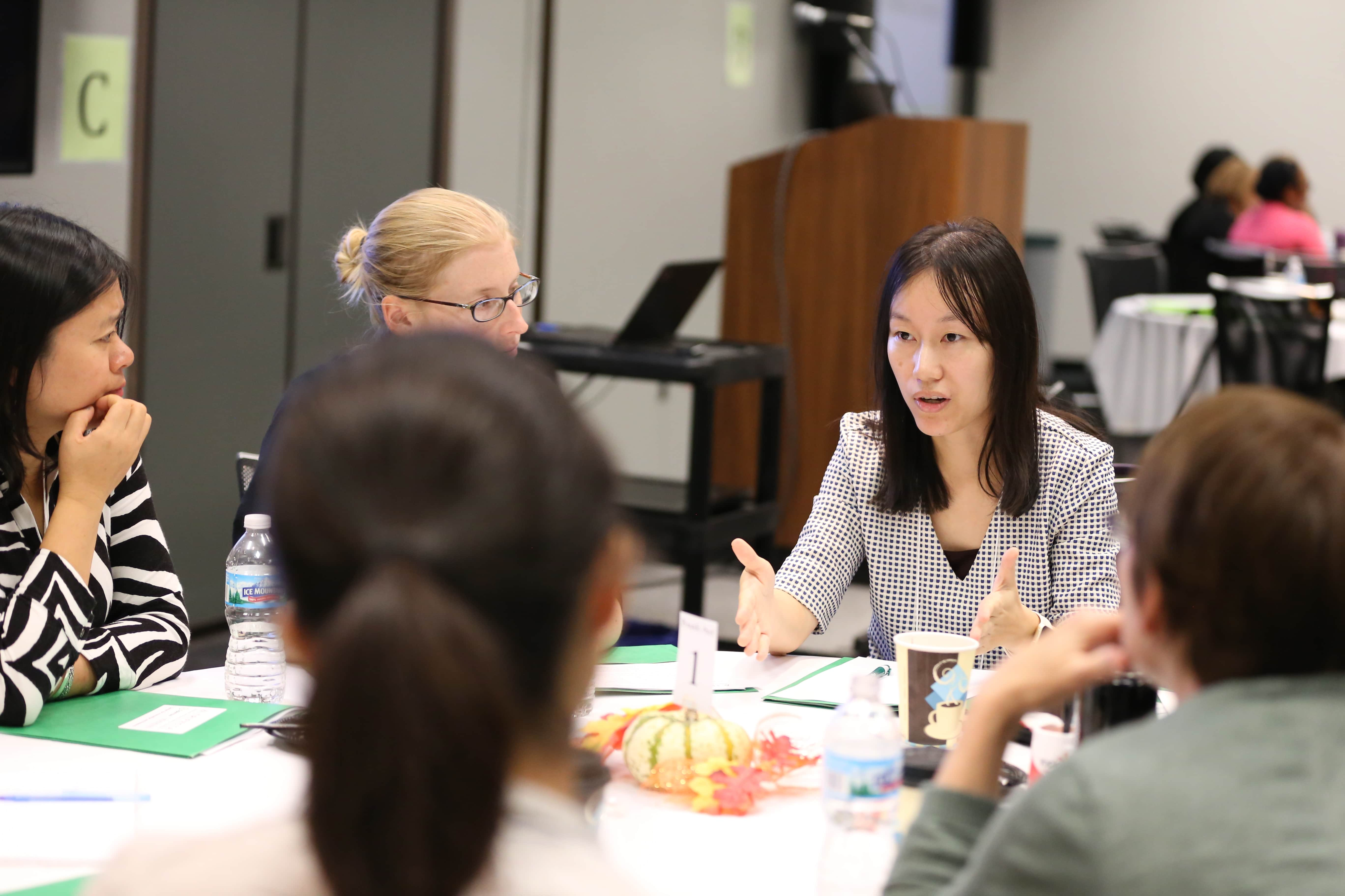 Jingbo Meng, an assistant professor of Communication at Michigan State University, talking with other researchers at the Trifecta kick off meeting.