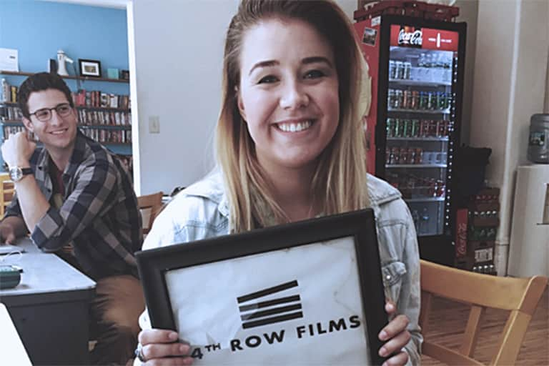 Student Liv Larsen at her desk at 4th Row Films.